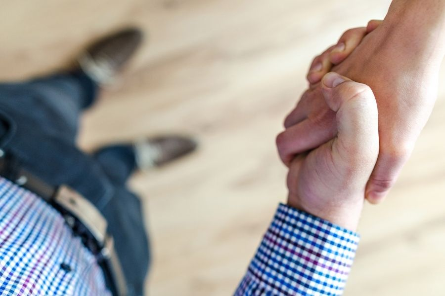Two men shake hands after a business negotiation where trust is the most important thing.